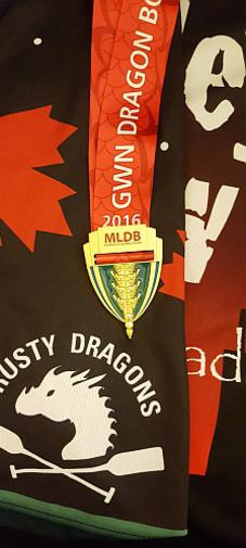 Picture of our 200m gold medal from the 2016 GWN Dragon Boat Challenge, shown on a Motlet Crew jersey as the background.